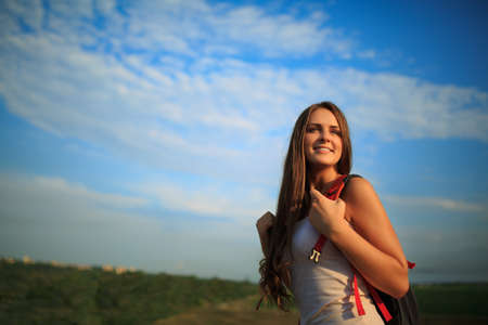 healthy people: Happy sportswoman with red backpack walking on sunset summer.