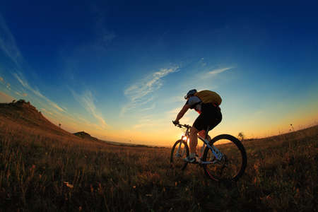 Silhouette of a bike on sky background on sunset Imagens - 45393486