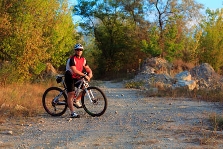 single track: Mountain Bike cyclist riding single track outdoor