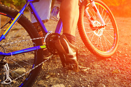 single track: Mountain Bike cyclist riding single track outdoor
