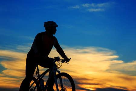 Cyclist Riding the Bike on the Beautiful Autumn Scene