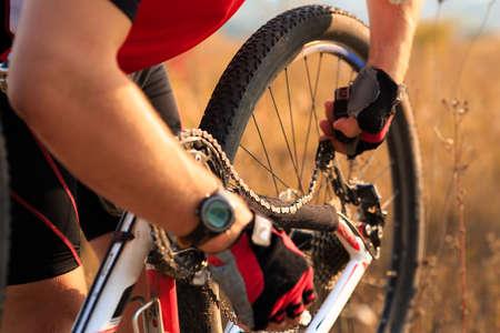 Bike Repair Young Man Repairing Mountain Bike In The Forest Stock