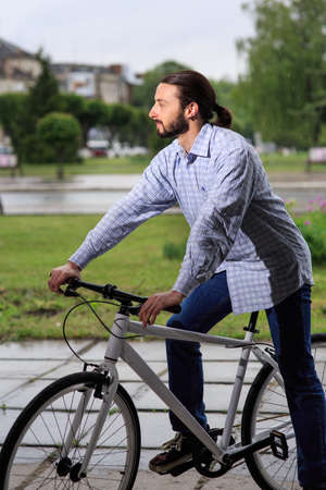 fixed: people, style, leisure and lifestyle - young hipster man with fixed gear bike on city street