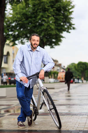 clavados: people, style, leisure and lifestyle - young hipster man with fixed gear bike on city street