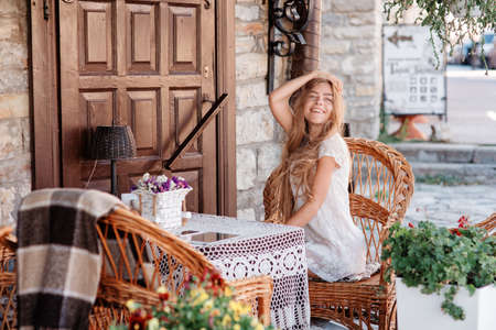looking aside: young woman in caffee looking aside. Fashion portrait Stock Photo