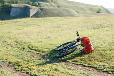 rack mount: Mountain Bicycle outdoor with orange bags for travel