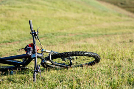 road bike: Mountain Bicycle outdoor with orange bags for travel