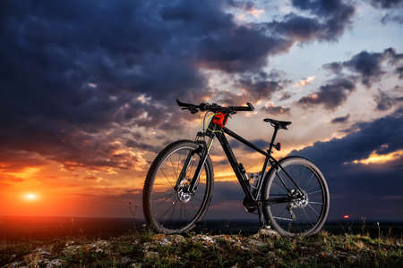 color bike, small parts of bike at the evening against sunset Imagens - 68777057