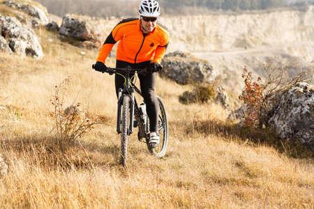 Mountain Bike cyclist riding Meadow track