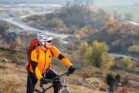 Bike cyclist with red backpack riding single track Stock Photo