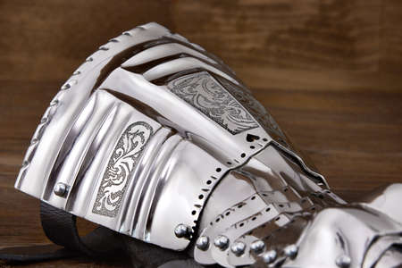 showpiece: Medieval metal glove, detail of part of ancient armor Stock Photo