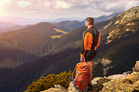 Man traveler with backpack hiking Travel Lifestyle concept adventure active summer vacations outdoor Stock Photo