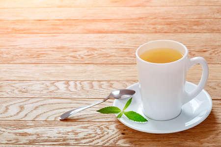 Hot earl grey tea with lemon slice top view on wood table