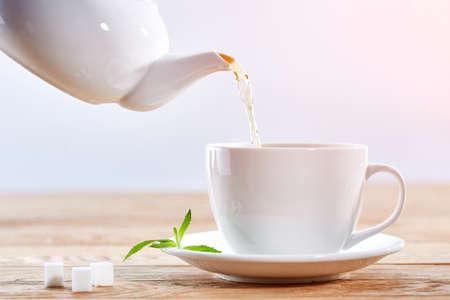 White mug on wooden table