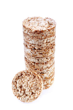 Diet rice cakes pile isolated on white background Stock Photo