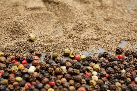 Spices on the stone black background. Condiments on a dark table. Banque d'images