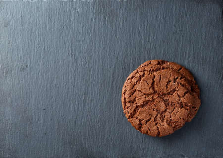 Close-up picture of chocolate cookies on dark background, shallow depth of field, lowkey. Extremely detailed. Delicious and tasty snack. Stock Photo