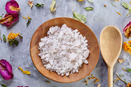Beautiful composition of spa treatment on white background. Concept spa background with salt in wooden bowl and spoon, close up, top view, selective focus, shallow depth of field. Spa natural concept. Spa and wellness setting. 스톡 콘텐츠