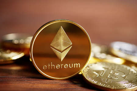 Ethereum on the pile of cryptocurrency over wooden table as most important cryptocurrency concept, close-up, selective focus. Cryptocurrency mining. Virtual business. Electornic commerce. Banking monetary. Cryptocurrency diversification.