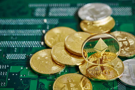Stack of cryptocurrencies in a circle on the motherboard. Cryptocurrency concept, close-up, selective focus. Some copy space. Cryptocurrency mining. Virtual business. Electornic commerce. Banking monetary. Cryptocurrency diversification.