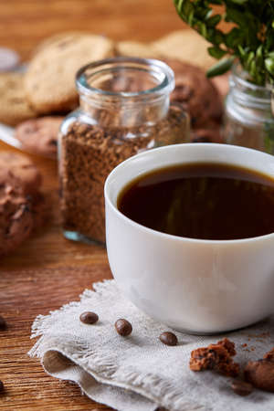 Breakfast background with mug of fresh coffee, homemade oatmeal cookies, grind coffee Stock Photo