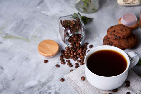 Breakfast background with mug of fresh coffee, homemade oatmeal cookies, grind coffee Stock Photo