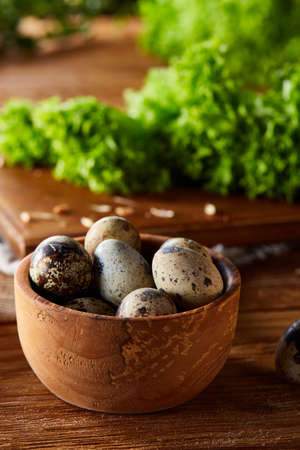 Preparation for making healthy salad with quail eggs, top view, close-up, selective focus