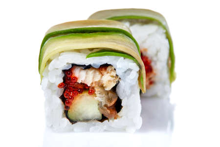 Traditional fresh japanese sushi rolls on a white background, close-up, selective focus. Sushi food japan. Delicious traditional asian food. Japanese cuisine. Oriental meal. Exotic food concept.