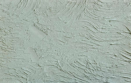 Green rough wall textured background. Abstact stucco. Texture of plaster on the wall. Macro, high resolution. Open space for your inscription. Abstract textured background. Indoor or outdoor stucco.