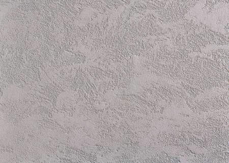 Fondo de textura de pared rugosa beige. Estuco abstracto. Textura de yeso en la pared. Macro, alta resolución. Espacio abierto para su inscripción. Fondo abstracto con textura. Estuco interior o exterior.
