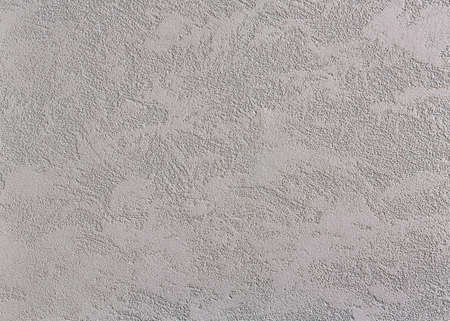 Beige rough wall textured background. Abstact stucco. Texture of plaster on the wall. Macro, high resolution. Open space for your inscription. Abstract textured background. Indoor or outdoor stucco.