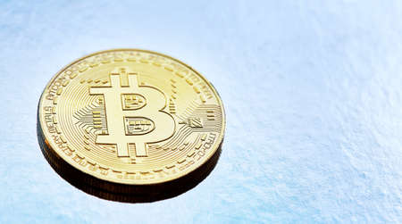 Bitcoin cryptocurrency with its shadow on wooden table, close-up, macro, selective focus, shallow depth of field. Some copy space for your inscription. Electronic commerce. Cryptocurrency concept. Imagens