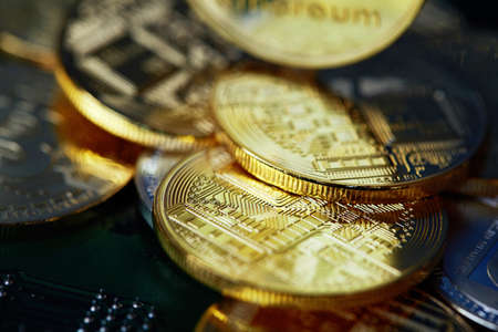 Stack of cryptocurrencies arranged on the motherboard. Bitcoin as most important cryptocurrency concept, close-up, selective focus. Cryptocurrency mining. Virtual business. Electornic commerce. Banking monetary. Cryptocurrency diversification.
