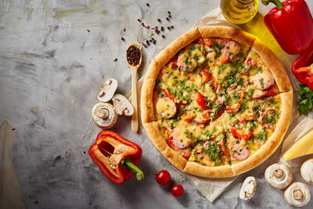 Tasty Italian pizza and its ingredients on white textured background, top view, close-up, selective focus. Delicious snack. Traditional homemade Italian pizza. Mediterranian cuisine. Fast food concept. Standard-Bild - 104816395