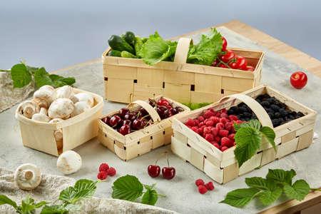 Harvest vegetables in wooden basket on light background
