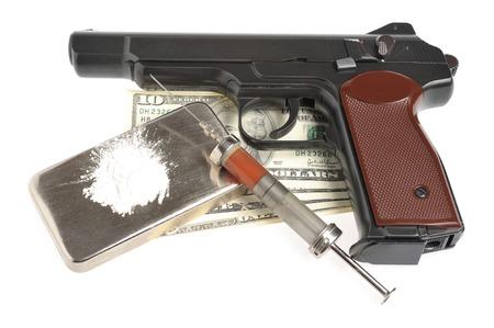 Drugs, syringe with blood, pistol, money isolated photo