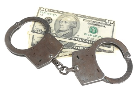 venal: Handcuffs and money isolated