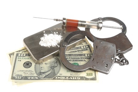 Drugs, syringe with blood, handcuffs and money on white background photo