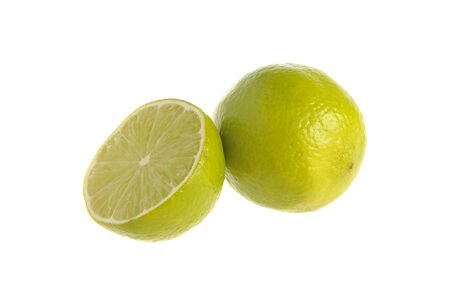 dietology: A half and a whole lime on the white isolated