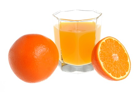 dietology: A half and a whole orange with a glass filled with citrus juice isolated on white  Stock Photo