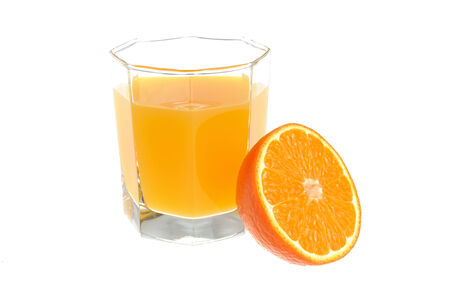 dietology: A half of orange with a glass filled with citrus juice isolated on white  Stock Photo