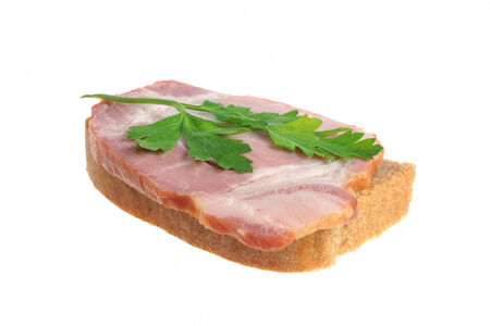 A ham sandwich with green leaf of parsley isolated on white background photo