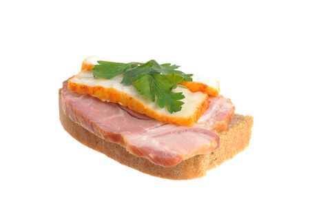A ham sandwich with lard and green leaf of parsley isolated on white background photo