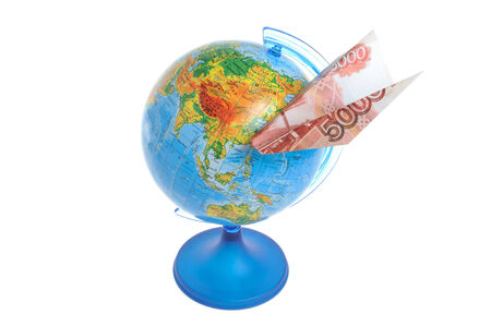 Globe with origami plane made from money isolated on white background photo