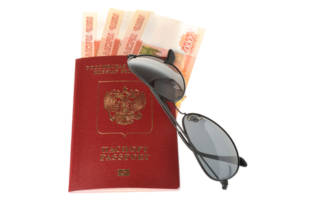 Sunglasses and Russian international passport with money isolated on white background photo
