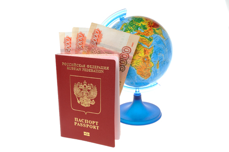 Russian Inaternational passport with money and globe isolated on white background photo