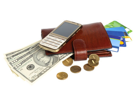 Leather purse with banknotes, coins, credit cards and mobile phone isolated on white background photo