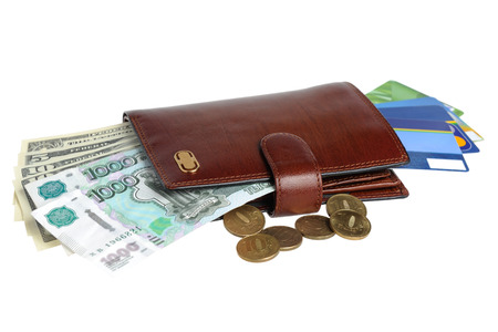 Leather purse with banknotes, coins and credit cards isolated on white background photo