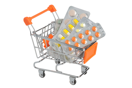 Shopping cart with medical supplies isolated on white background photo