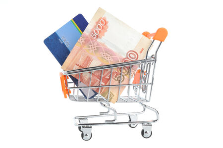 non cash: Credit card and money within shopping cart isolated on white background